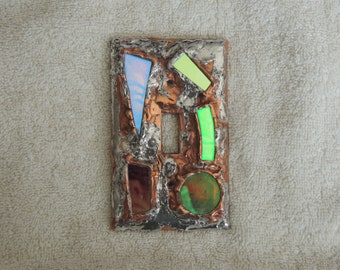 Copper and Pewter light switch plate with Dichroic glass