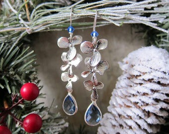 Luminous Bloom in Icy Blue - Matte Silver Floral earrings with Blue Crystal