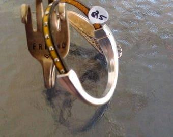 Studded  yellow leather bangle bracelet.