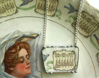 Recycled china necklace. Broken china jewelry necklace, antique, 1916 calendar plate - July 1916, bluebird