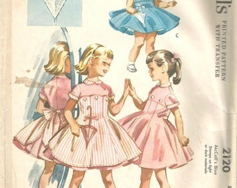 1950s Girls' Dress & Button-On Pinafore Parasol Pocket Sleeveless or Short Sleeves McCall's 2120 Size 4 Girls' Vintage Sewing Pattern