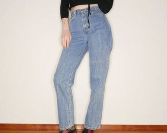 90s Medium blue wash Calvin Klein denim jeans 26 inch waist