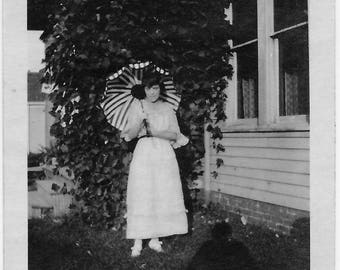 Old Photo Woman wearing White Dress holding Striped Umbrella Photographers Shadow 1910s Photograph Snapshot vintage
