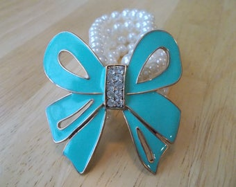 4 Row White Pearl Stretch Cuff Bracelet with a Big Turquoise Bow and Clear Rhinestones
