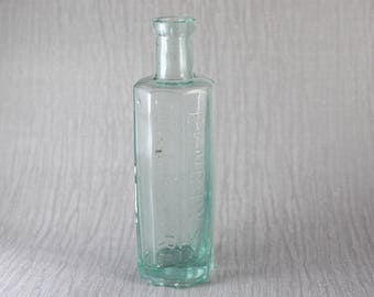 Small Vintage Benbow's Dog Mixture Clear Glass Green Tint Octagonal Shaped Bottle with Cork Style Top Hinge Moulded