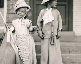 Vintage photograph of children wearing fancy dress. Edwardian period.