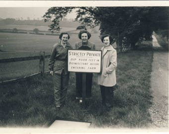 Women at farm, with warning notice, Vintage photograph c1940s