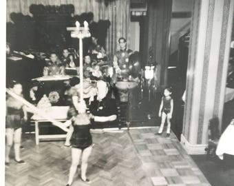 vintage black and white photo of dancers, one balancing something on her head
