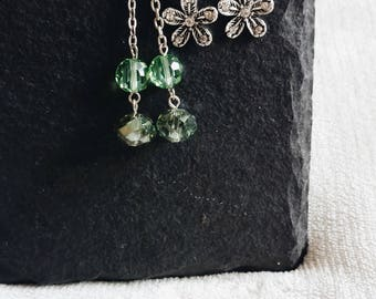 Set of two dainty green and silver bead and floral dangling earrings