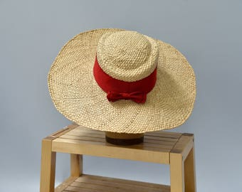 1940's straw wide brim hat with red ribbon bow