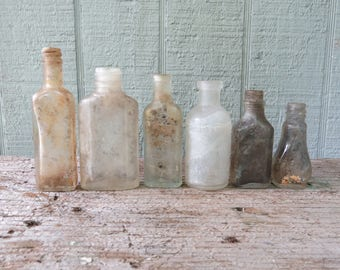 6 Small Grungy Antique Bottles Assorted Sizes and Shapes