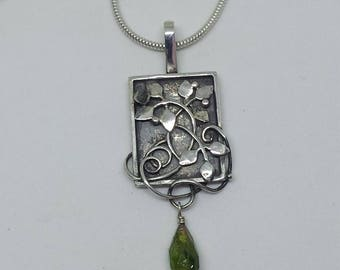 Sterling Silver Threshold Pendant with a rough blue diamond and a green Tourmaline drop.