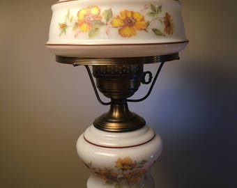 Vintage electric hurricane parlor lamp by L and L WMC from the 70s
