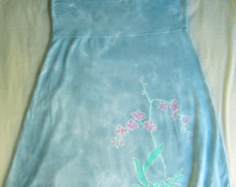 Hand-dyed medium-size batik skirt with orchid design in blue and pink