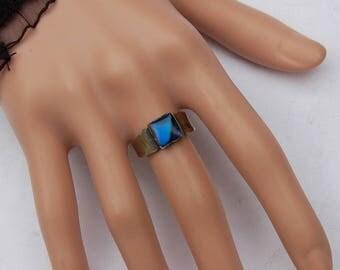 Sterling Silver Vintage Ring with a fine cut Blue Sapphire gem.      Unique design.