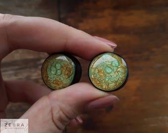 """Golden green galaxy ear plugs wood gauges 4,6,8,10,12,14,16,18,20,22,24,25-60mm;6g,4g,2g,0g,00g;1/4,5/16,3/8,1/2,9/16,5/8,3/4,7/8,1 1/4,1"""""""