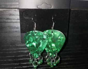 Green guitar pick earrings