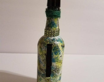 Decorated green hand painted beer bottle, hand stenciled paint