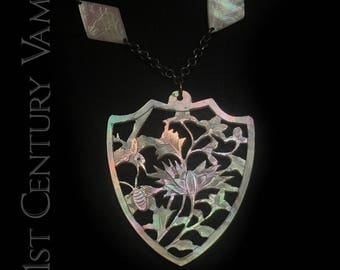 1920s Sautoir Necklace. Hand carved Mother of Pearl. Hummingbirds. Flowers. Diamonds. Shield. Flapper. Jazz Age. Art Deco.
