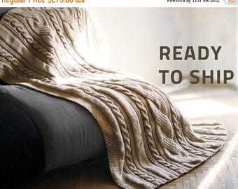 30% Off Sale Cable knit blanket. Size: 46x69 inches