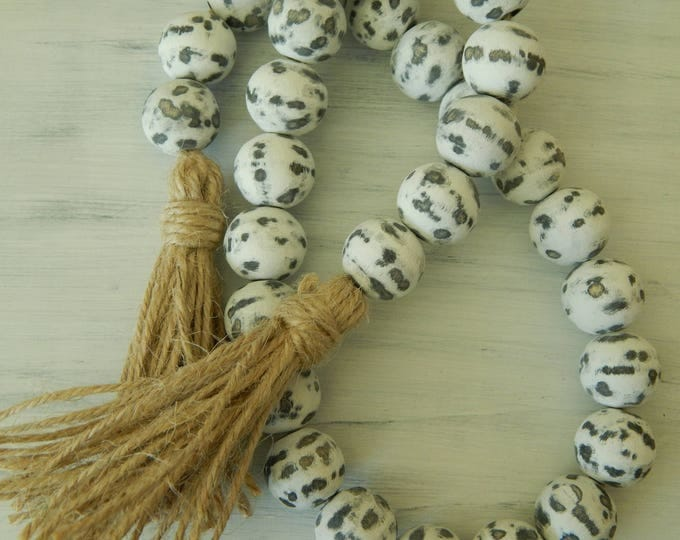 Featured listing image: Chippy wood bead garland with double jute tassel, jewelry for the home, distressed garland, farmhouse beads, farmhouse swag, rustic decor