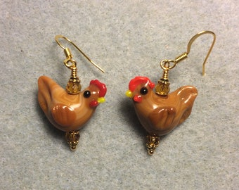 Coffee colored lampwork chicken bead earrings adorned with topaz Chinese crystal beads.