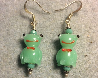 Opaque light green lampwork frog bead earrings adorned with light green Chinese crystal beads.