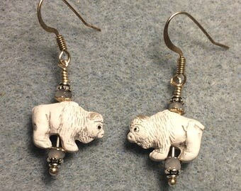 Small white ceramic buffalo bead earrings adorned with small white Chinese crystal beads.