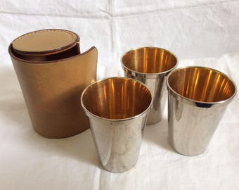 A Cased Set of 3 Silver Metal and Gilded Cups.