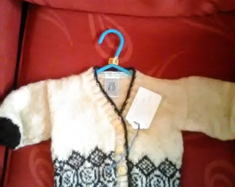 Hand knitted cardigan,  knitted with home spun wool, to fit a child aged 6-12 months old