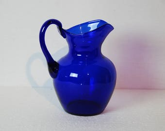 French vintage blown glass blue  coloured water or wine jug, 1980s. Deep blue colour with large spout and big handle