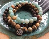 Grounding, Creativity + Self Expression Stack of 3 Spiritual Junkies Agarwood, Picture Jasper, Amazonite + Hill Tribe Om Yoga Bracelets