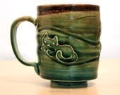 Three cats in undulating waves. Rainbow glazed. Wheel-thrown ceramic mug. 12 fl oz