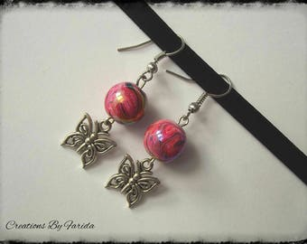 earrings with a butterfly pendant and a Pearl Pink effects wave