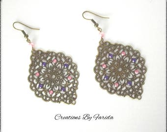 Earrings bronze pendant with a print and purple and pink rhinestones