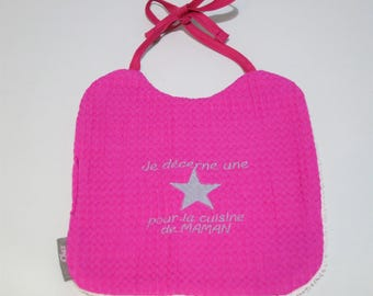 Pink reversible, embroidered bib.