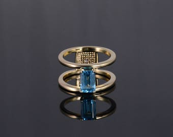 14k 2.40 Ct Blue Topaz Emerald Cut Suspended Ring Gold