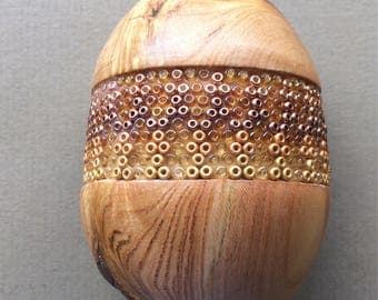 Wooden egg made of yew wood