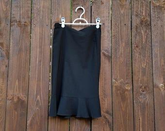 black RICKI'S brand knee-length women's ruffly skirt