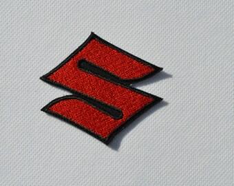 embroidered badge has the suzuki machine
