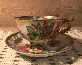 Shafford Hand Decorated Three Footed Iridescent Tea Cup and Saucer
