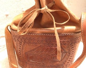 Vintage mid-century modern hand-tooled leather purse