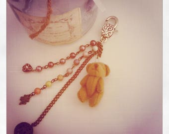 Pearl handbag and teddy bear