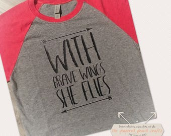 With brave wings she flies baseball raglan
