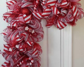 Close Out Candy Cane Deco Mesh Wreath - Candy Cane Shaped Wreath with Candies, Glitter Balls, Striped Ribbons, Red Tubing - Holiday Door Dec
