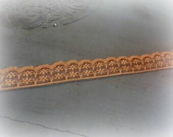 orange color lace - 100 cm long and 2 cm wide