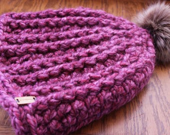 pink/mauve hand crocheted wool blend beanie with faux fur pom pom