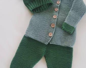 Handknitted baby costume