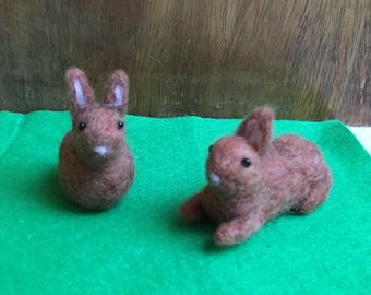 Cute Needle-Felted Easter Bunnies Sitting Up And Lying Down In Light Brown , White Tail And Black Bead Eyes