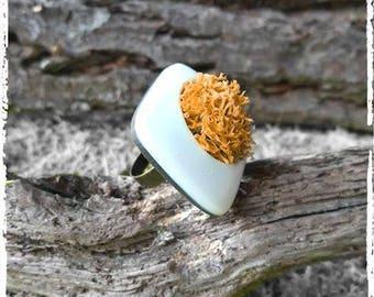 White and orange designer ring